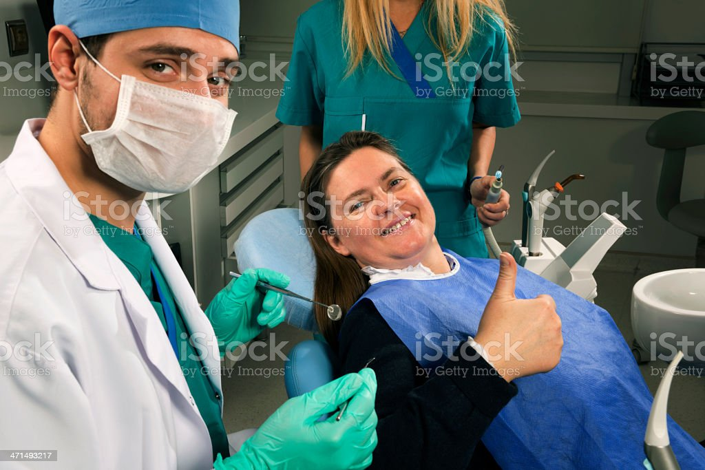Dentist and his patient doing ok sign royalty-free stock photo