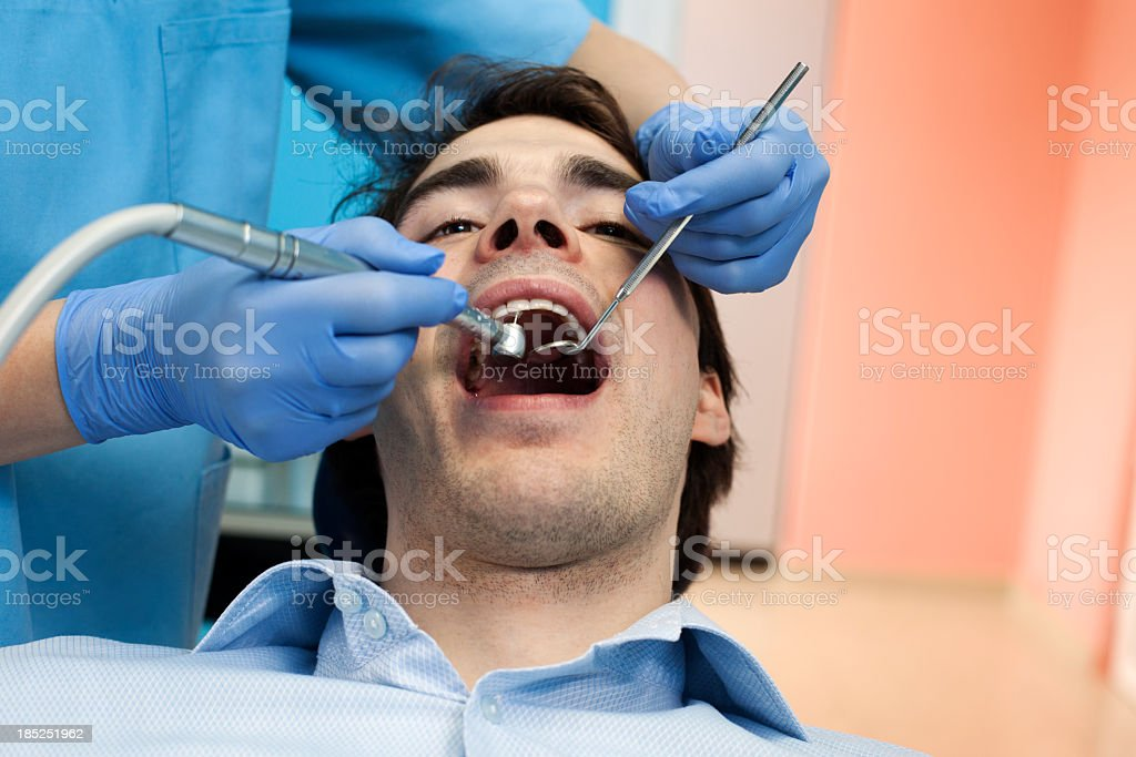 Dentist and male patient royalty-free stock photo