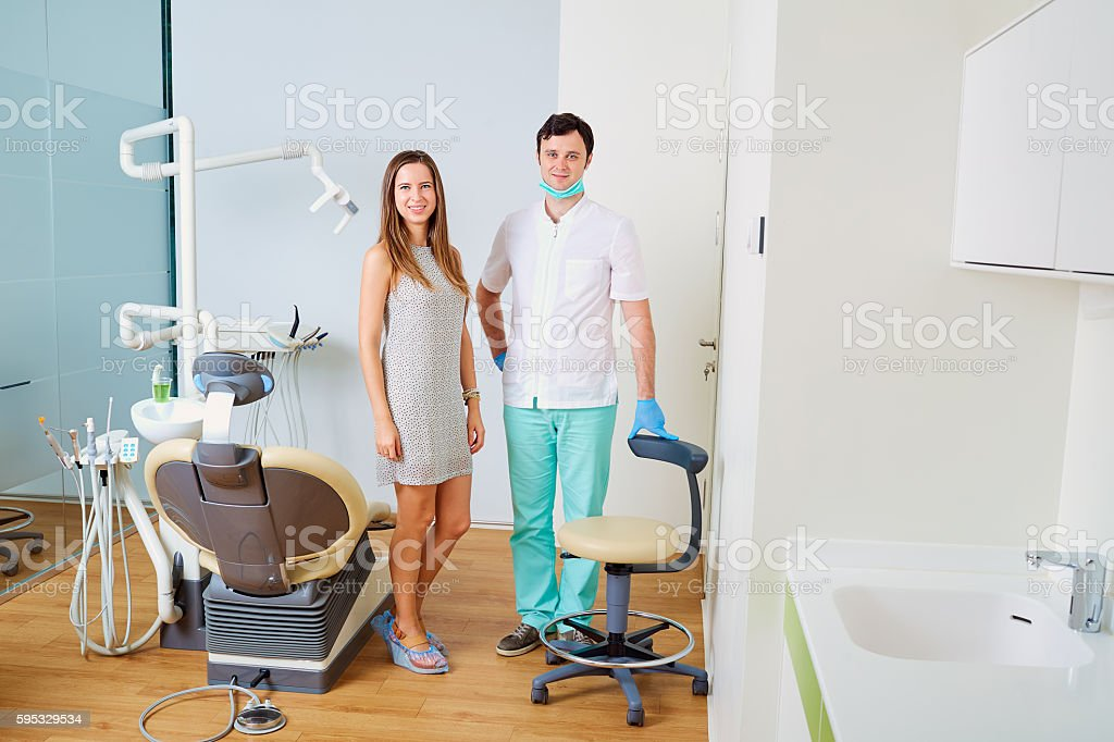 Dentist and patient   office. Dental treatment stock photo