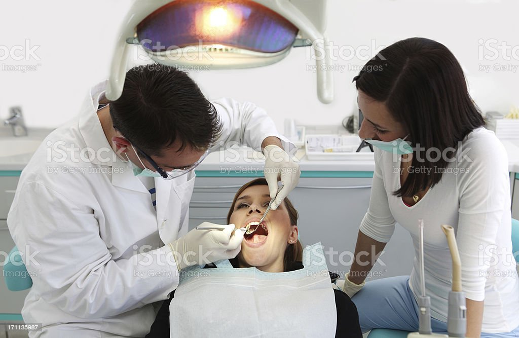 Dentist and two beautiful girls royalty-free stock photo