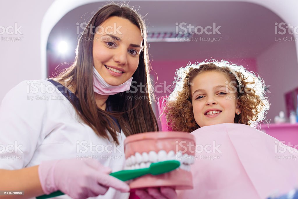 Dentist and young patient stock photo