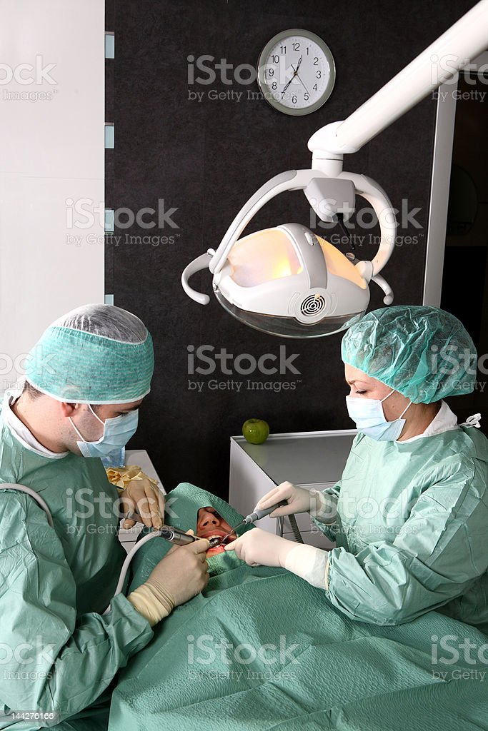 Dentist at work in dental room royalty-free stock photo