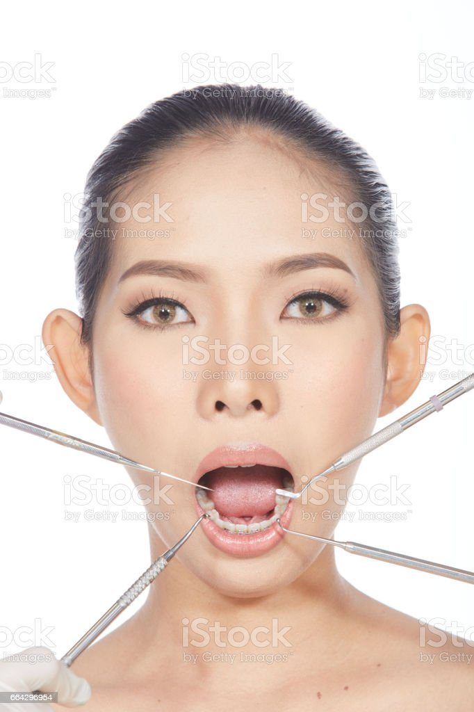 Dentist check mouth of Patient with dental equipment instrument stock photo