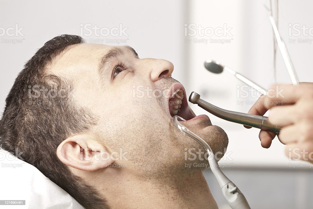 Dentist checks the patient's teeth royalty-free stock photo