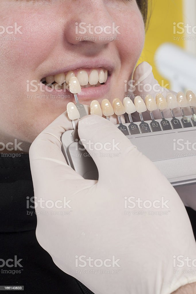 dentist choose white of teeth royalty-free stock photo