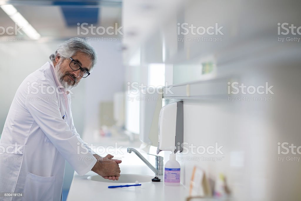 Dentist doctor washing hands at the dentistoffice stock photo