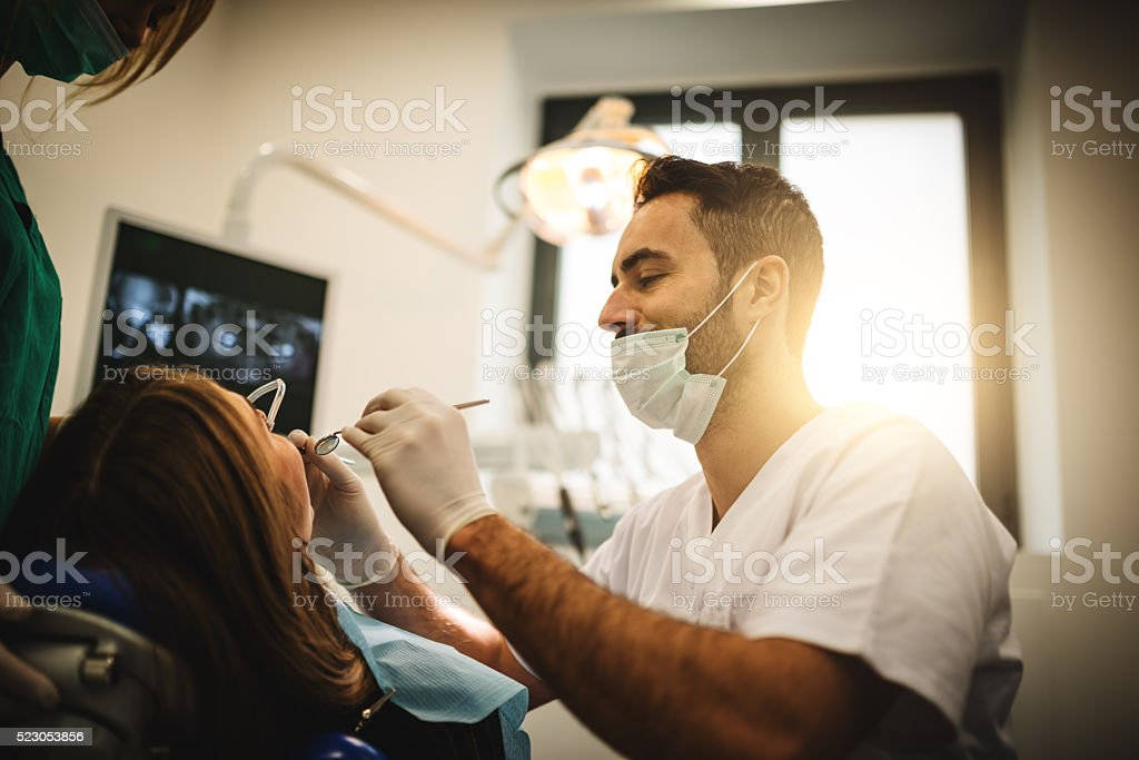 dentist doctor with the assistant in the clinic stock photo