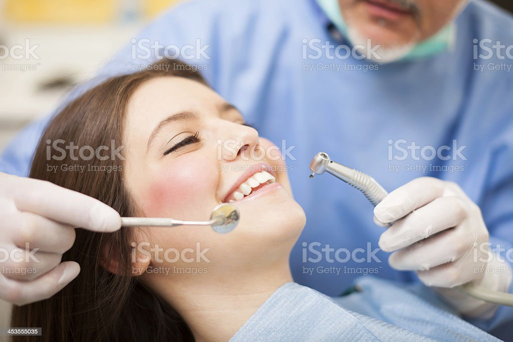 Dentist doing a treatment royalty-free stock photo
