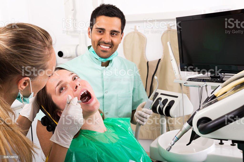 Dentist examines the oral cavity stock photo