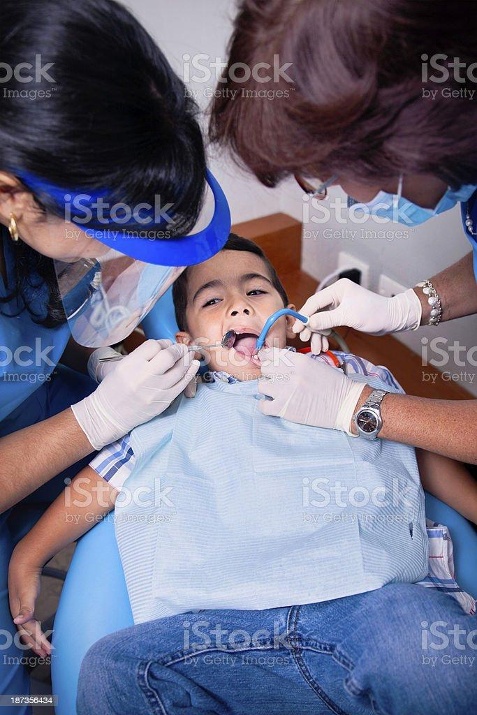 Dentist examining child royalty-free stock photo