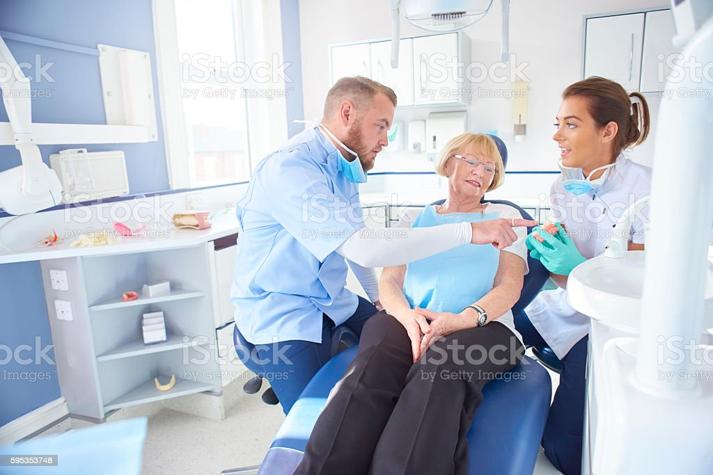 dentist explaining the problem stock photo