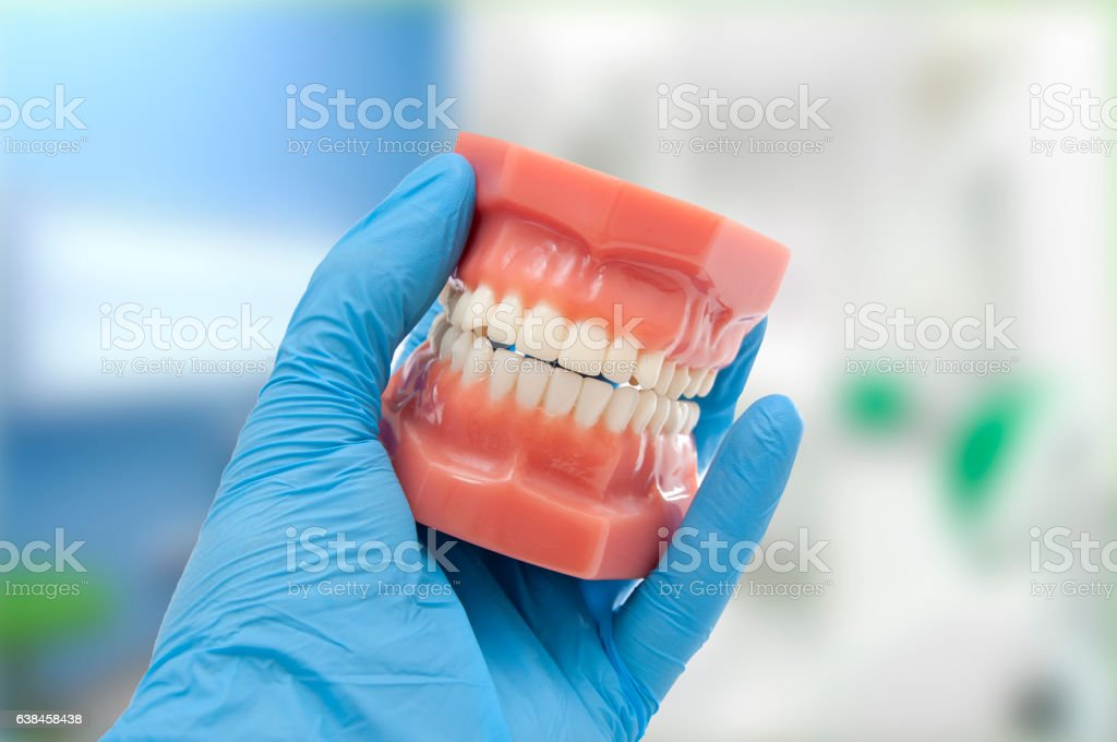 dentist hand show perfect smile stock photo