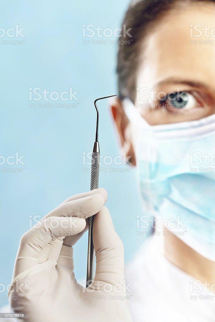 Dentist Holding Up Sickle Probe stock photo