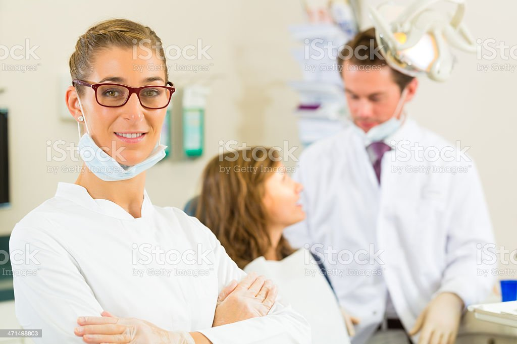 Dentist in her surgery royalty-free stock photo