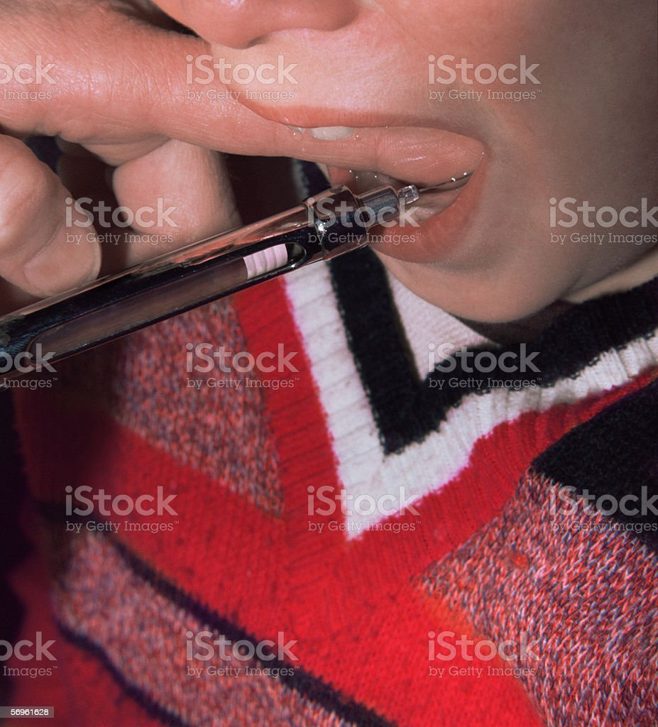 Dentist injecting patient royalty-free stock photo