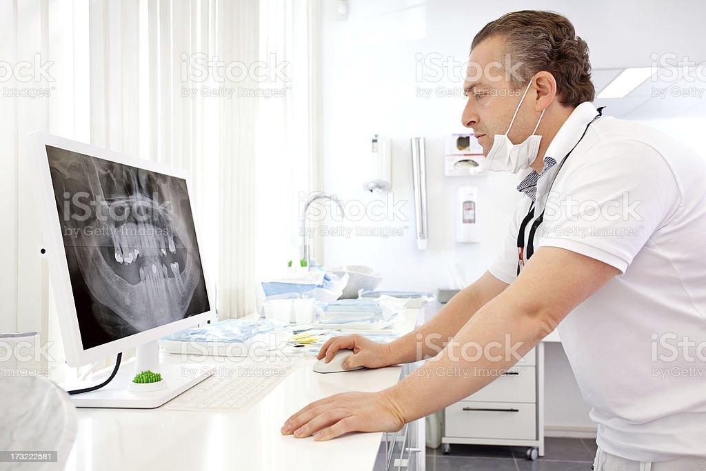 dentist looking at x-ray image royalty-free stock photo