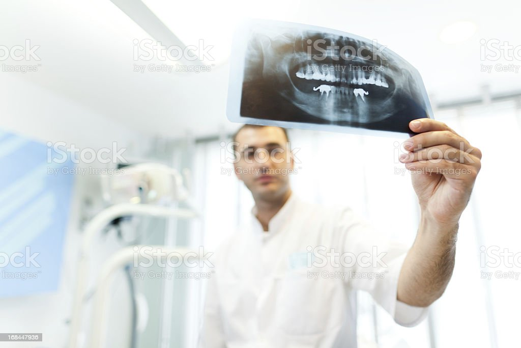 Dentist looking to X-ray royalty-free stock photo