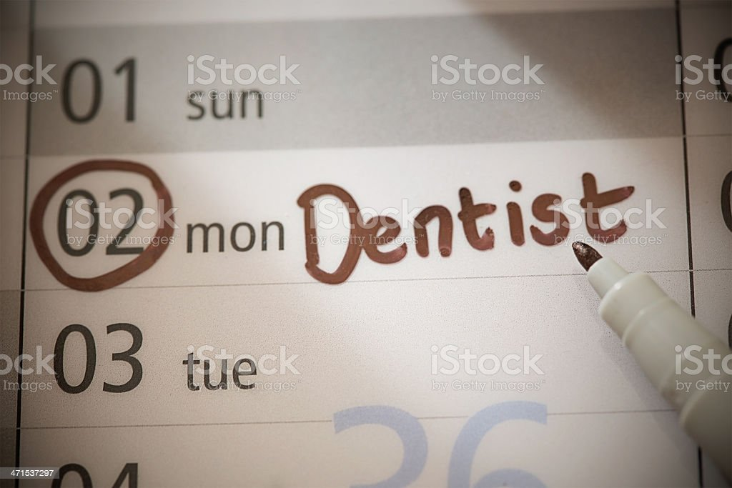 Dentist marked for a Monday on non-specific calendar royalty-free stock photo