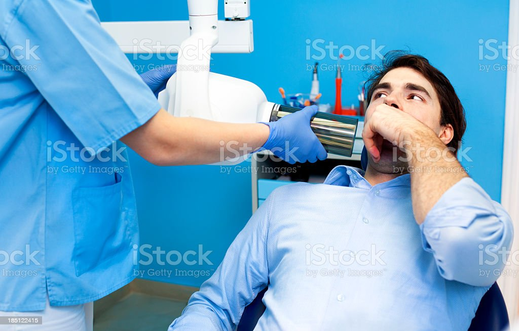 Dentist Professional Preparing  X-Ray for Patient royalty-free stock photo