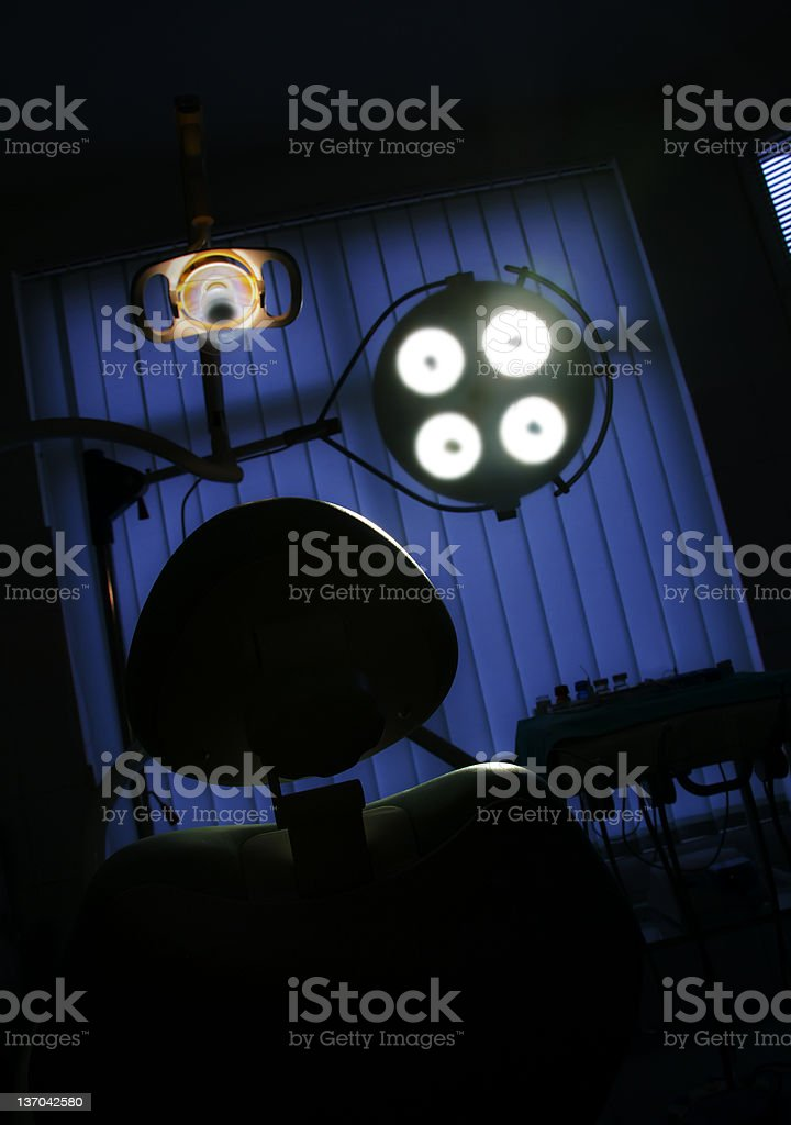 Dentist room and treatment chair stock photo