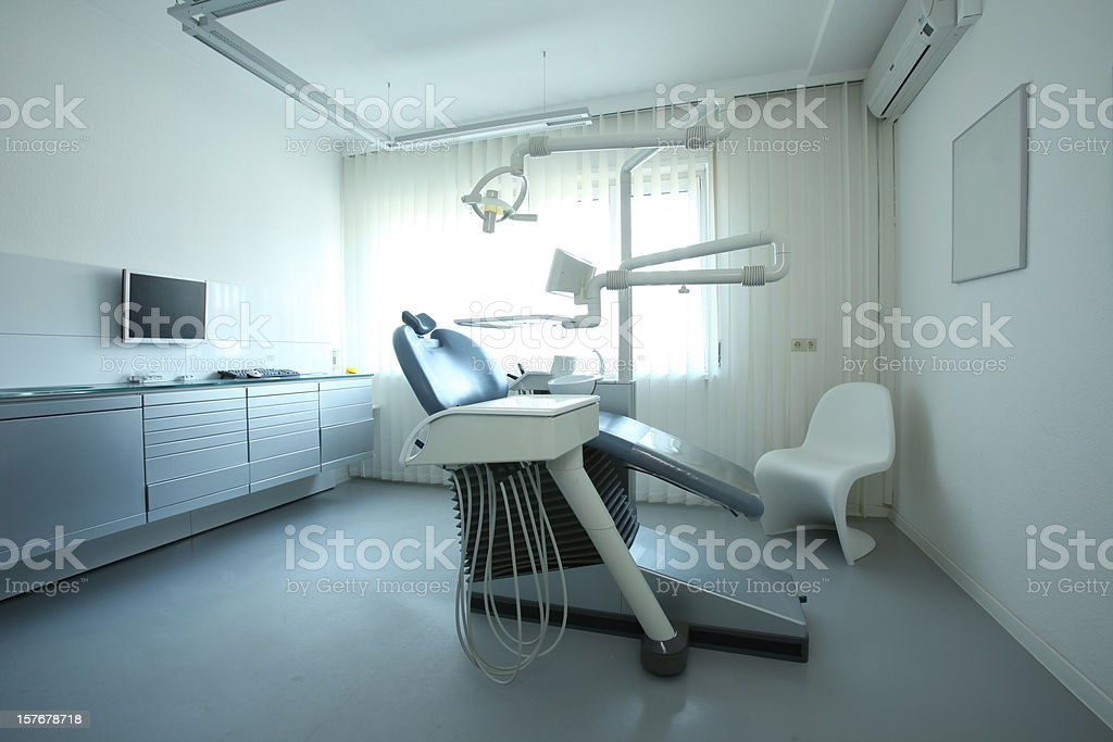 Dentist room and treatment chair royalty-free stock photo