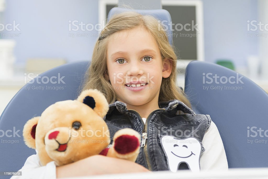 Dentist Teaching Brushing Teeth to a Girl stock photo