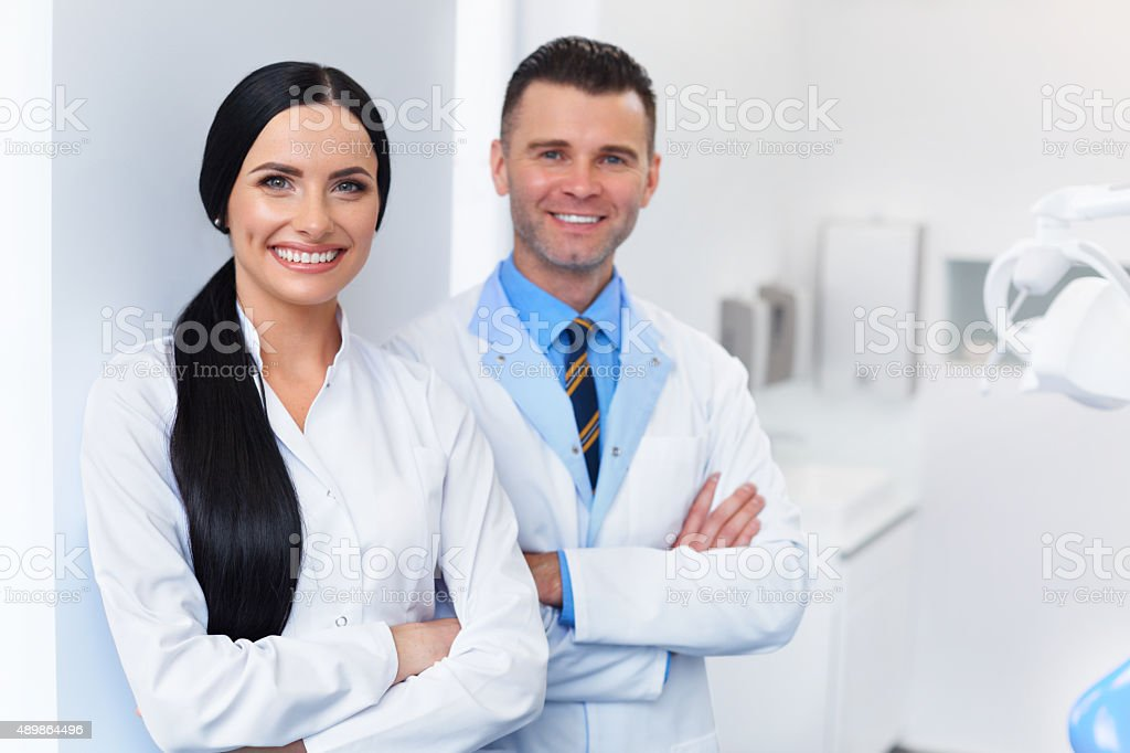 Dentist Team at Dental Clinic. Two Smiling Doctors stock photo
