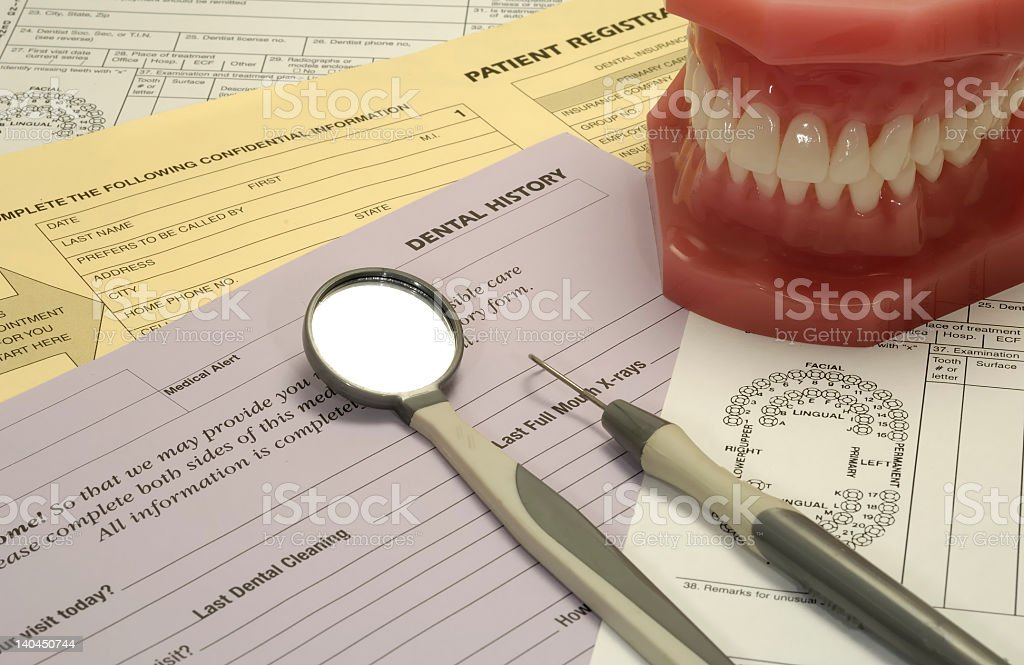 Dentist tools, teeth, and dental forms royalty-free stock photo