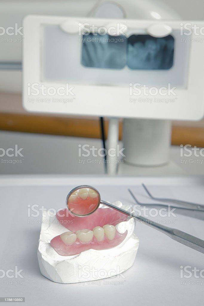 dentist tools with acrylic denture (False teeth) royalty-free stock photo