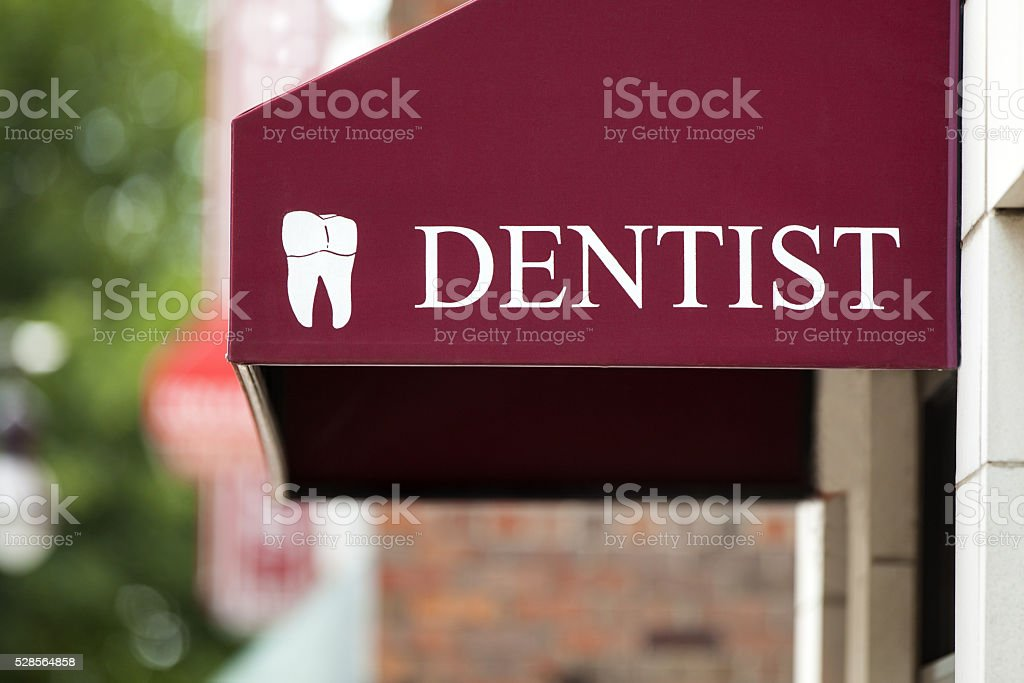 Dentist Tooth Sign Awning stock photo