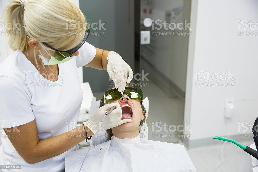 Dentist using a modern diode dental laser stock photo