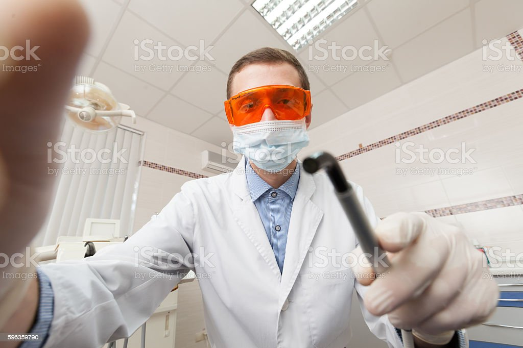 Dentist while working stock photo
