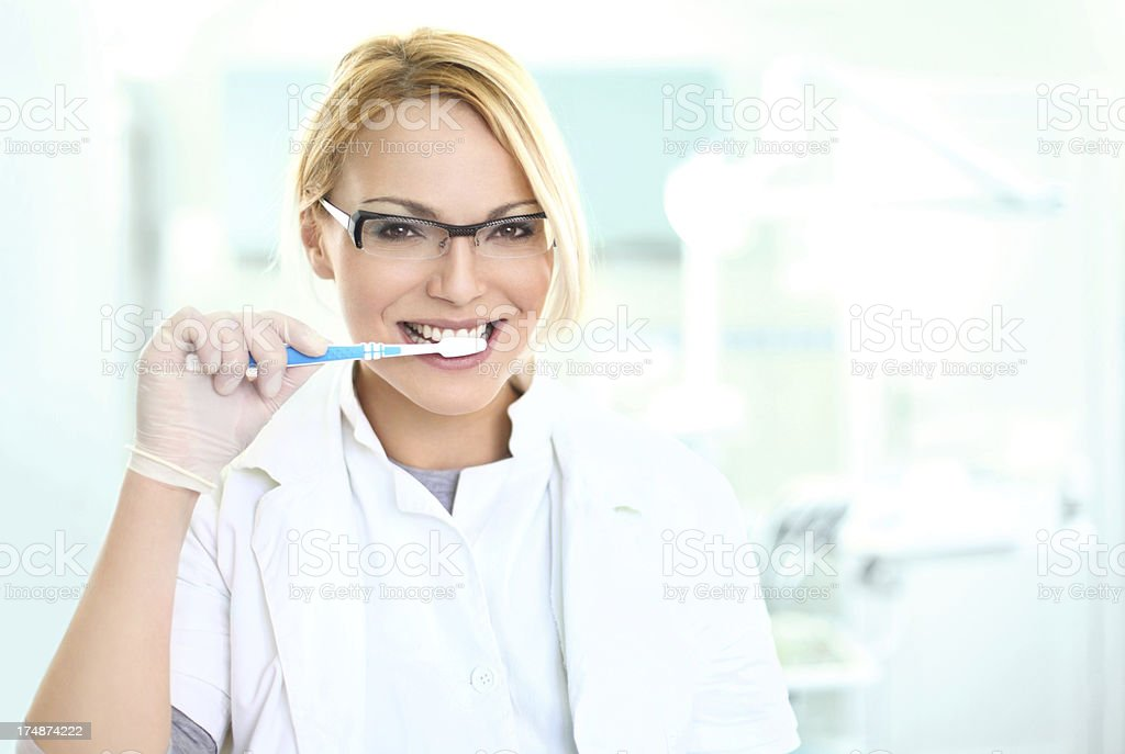 Dentist with a tooth brush. royalty-free stock photo
