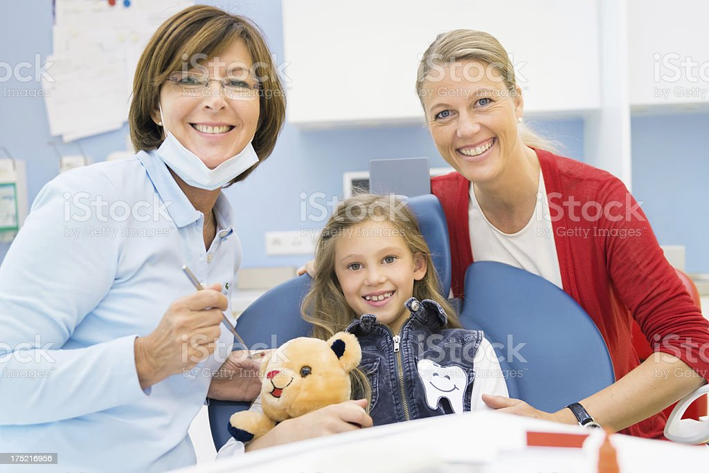 Dentist with Mother and Girl stock photo