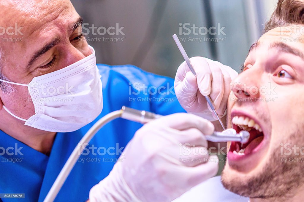Dentist With Patient in Surgery stock photo