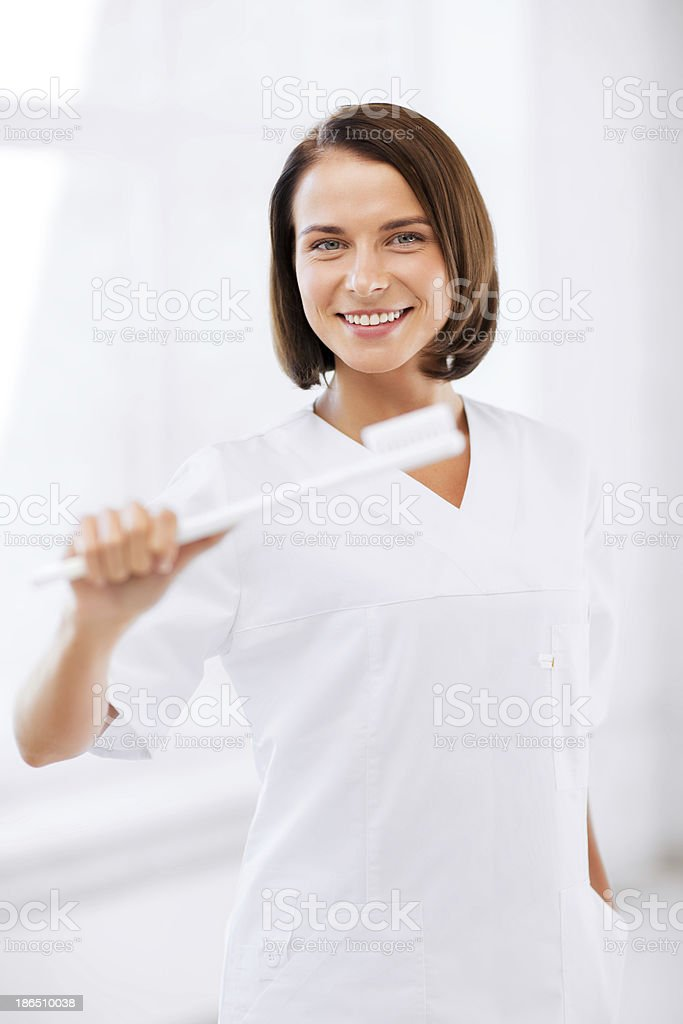 dentist with toothbrush in hospital royalty-free stock photo