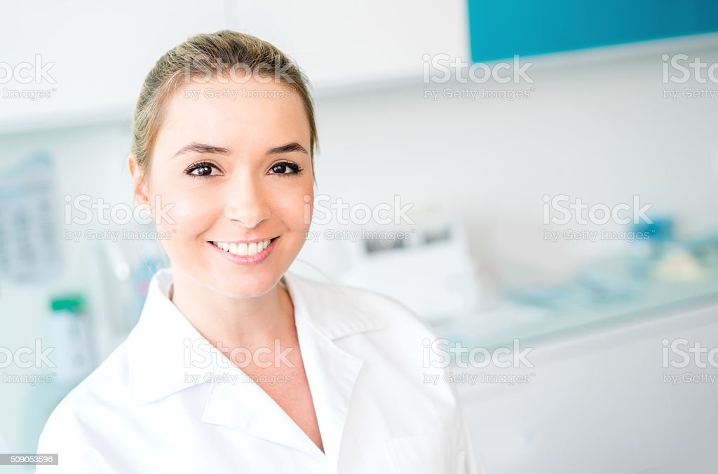 Dentist working at her practice stock photo