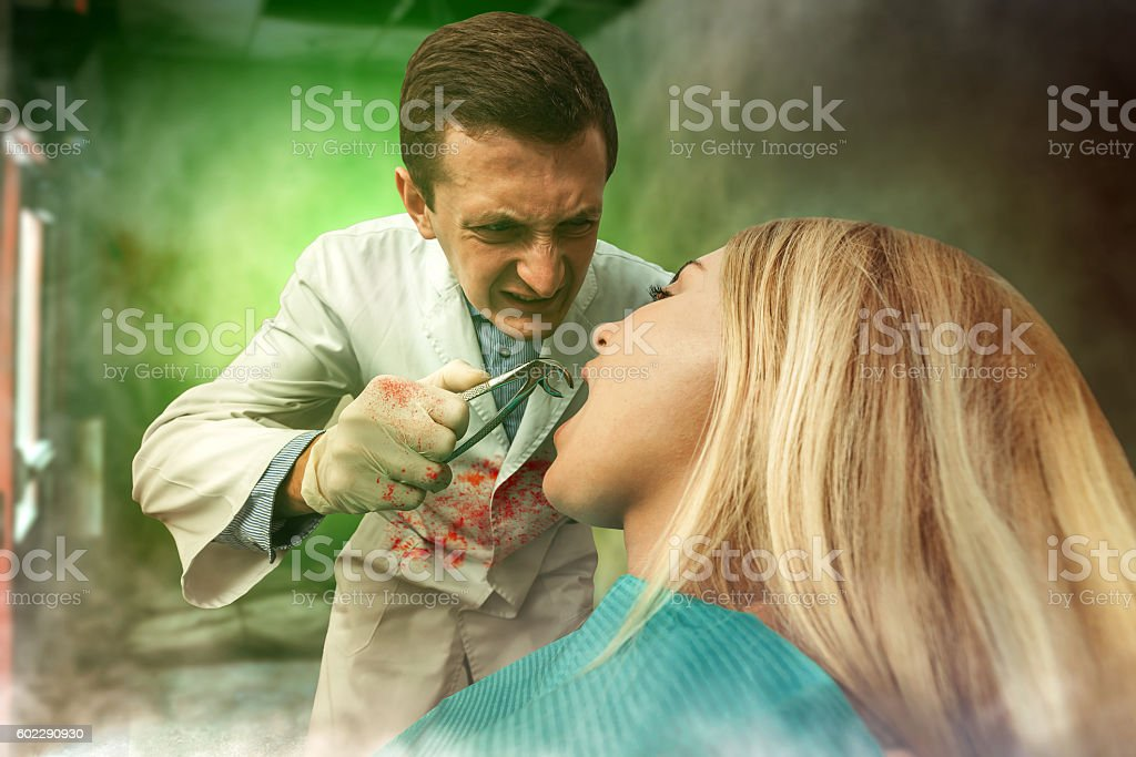 Dentist working with woman stock photo
