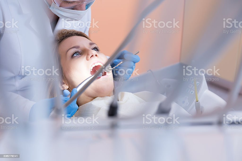 Dentistry examining patient's teeth stock photo