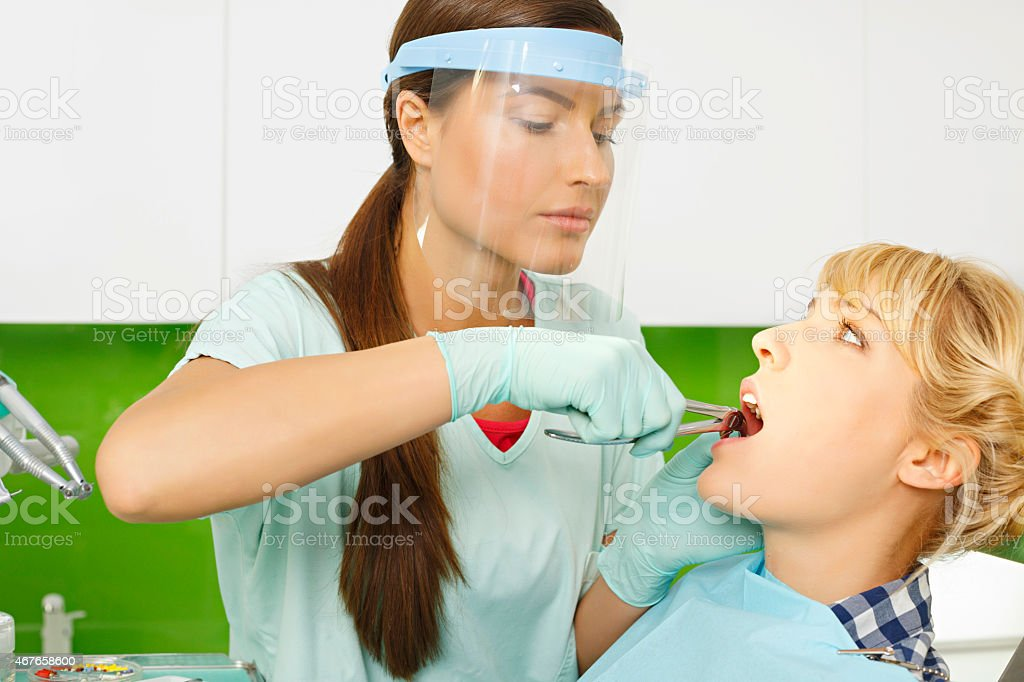 Dentistry Tooth  Extraction   Dentist working  Dental Tooth  Extraction Forceps stock photo