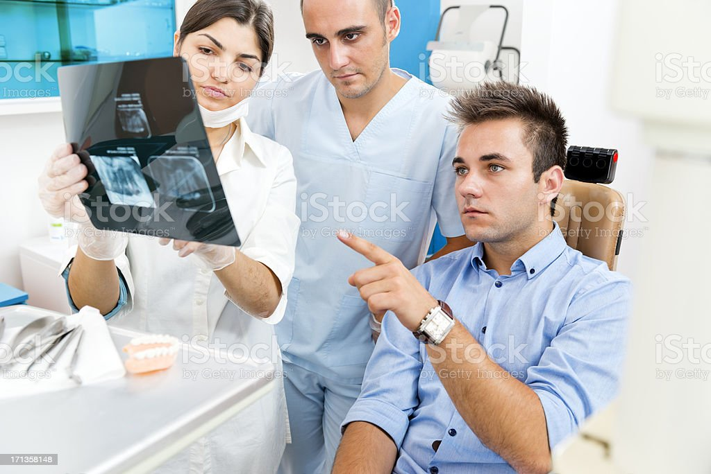 Dentists discussing with the patient royalty-free stock photo