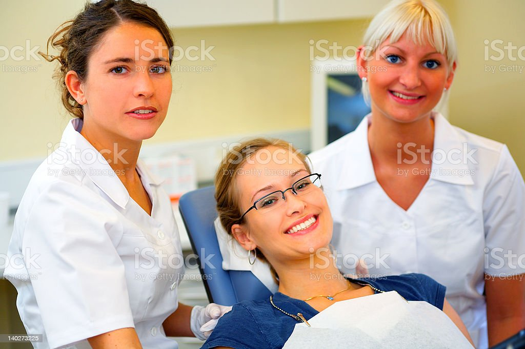 Dentists with a female patient royalty-free stock photo