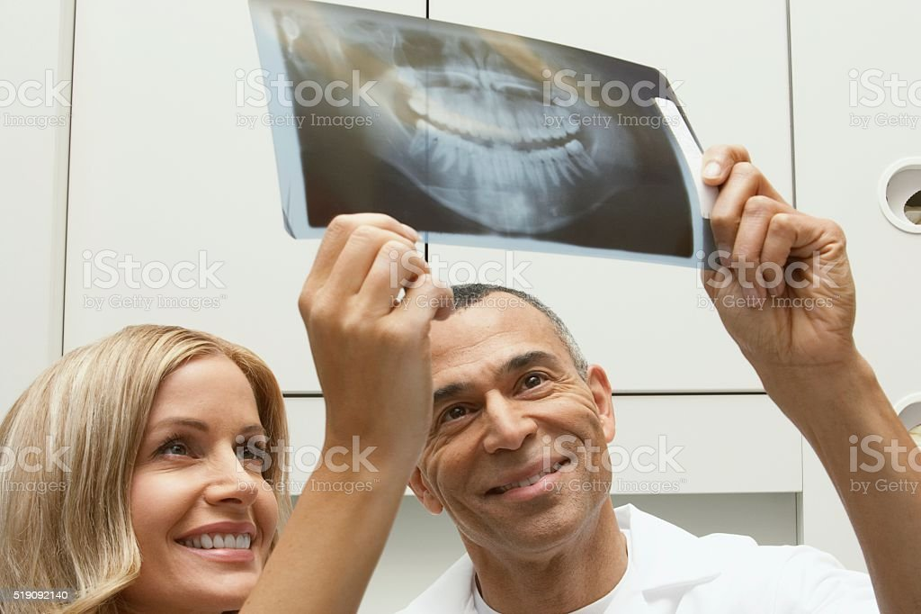 Dentists with x-rays stock photo