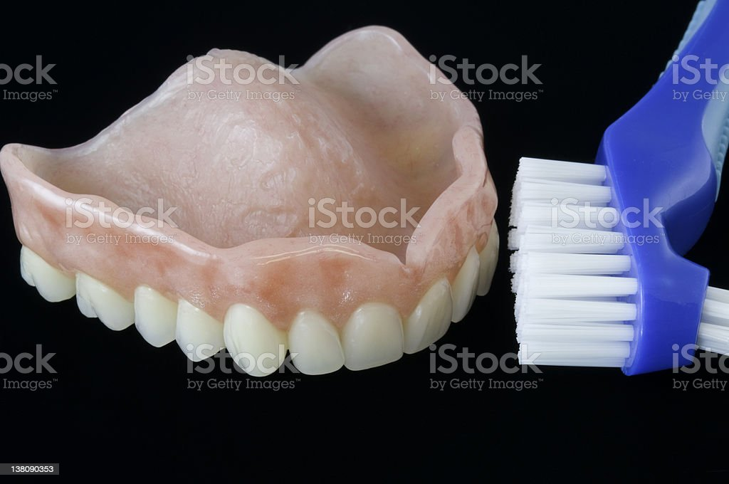 denture and cleaning brush royalty-free stock photo