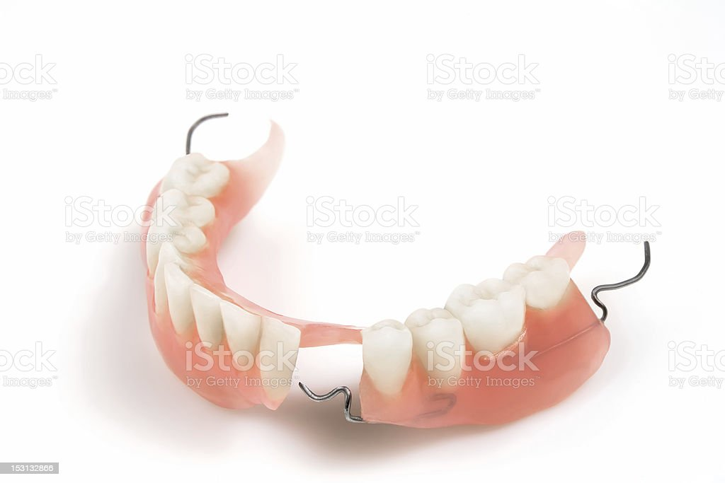 Denture with irons isolated in white stock photo