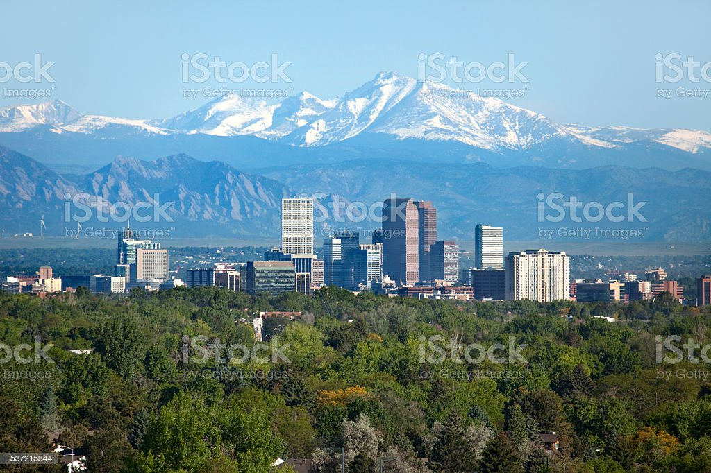 Denver Colorado skyscrapers snowy Longs Peak Rocky Mountains summer stock photo