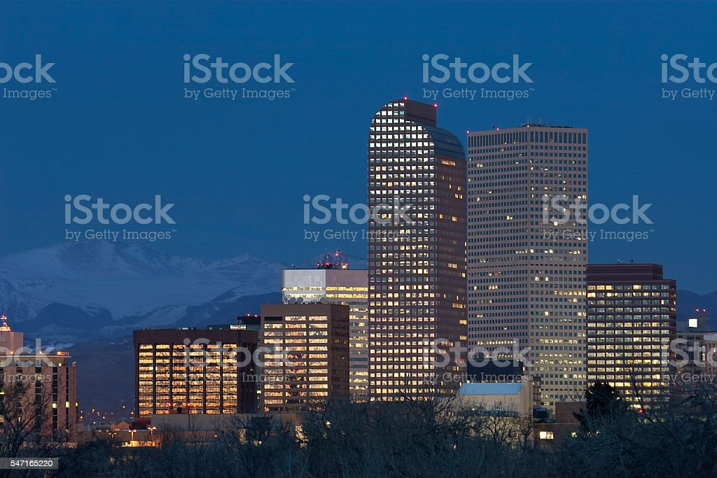 Denver skyscrapers with snowy Mount Evans and Rocky Mountains stock photo