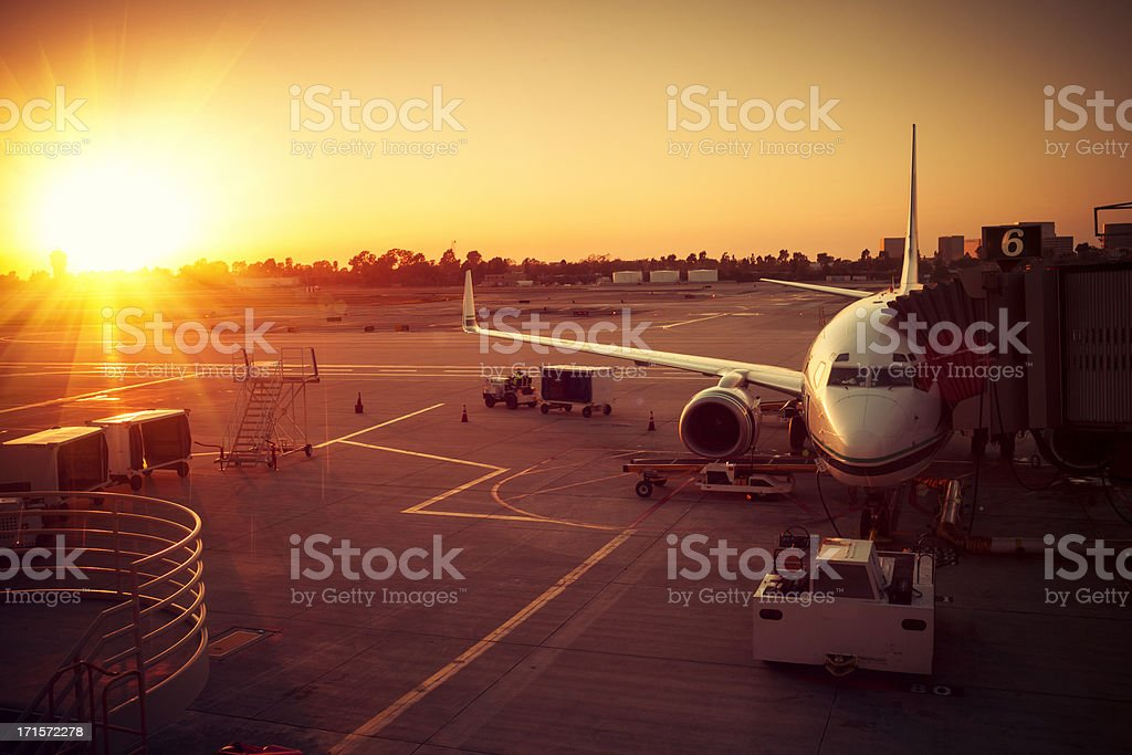 Deparing Airplane in Sunset, Airport stock photo