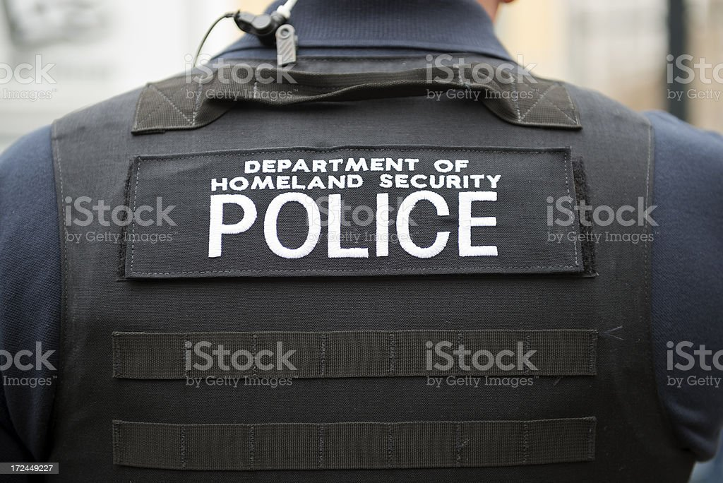 Department of Homeland Security vest and officer stock photo