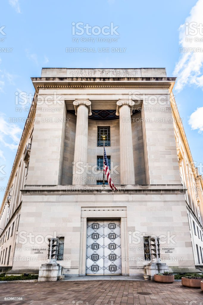 Department of Justice building with signs stock photo